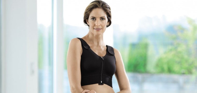 The black compression bra has a zip front fastener and straps with a velcro fastener to make easy dressing and undressing easy after brest surgery and breas augmentation.