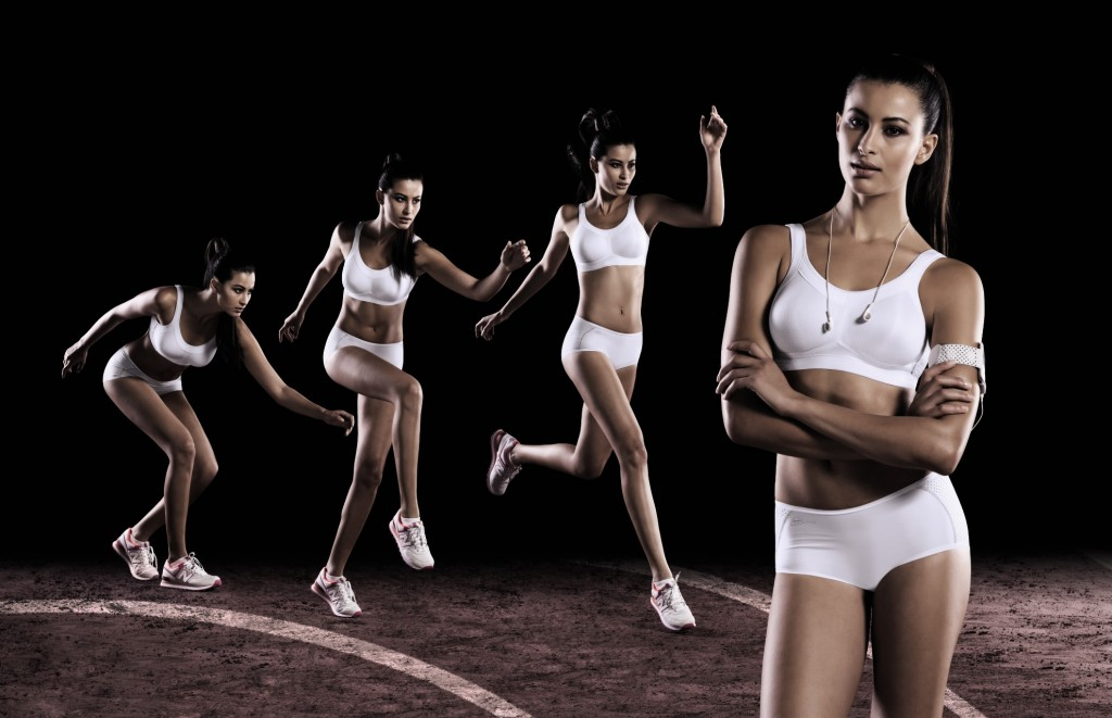 Girl running in a white high impact sports bra from Anita active.