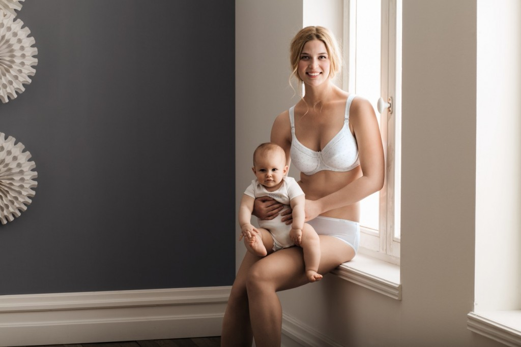 Anita maternity nursing bra in white with high cotton content and easy breast feeding funtion. For large cups and sizes.
