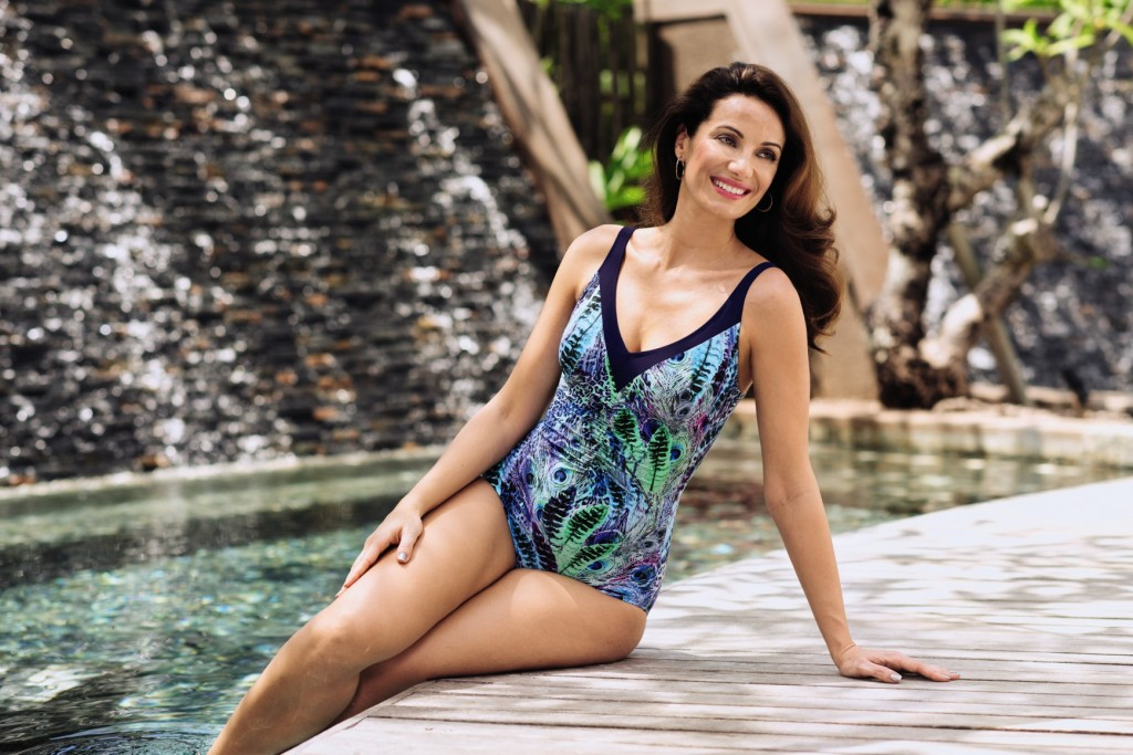 Swimming costumes for plus sizes and curvier figures in a bright blue and green peacock colour print.