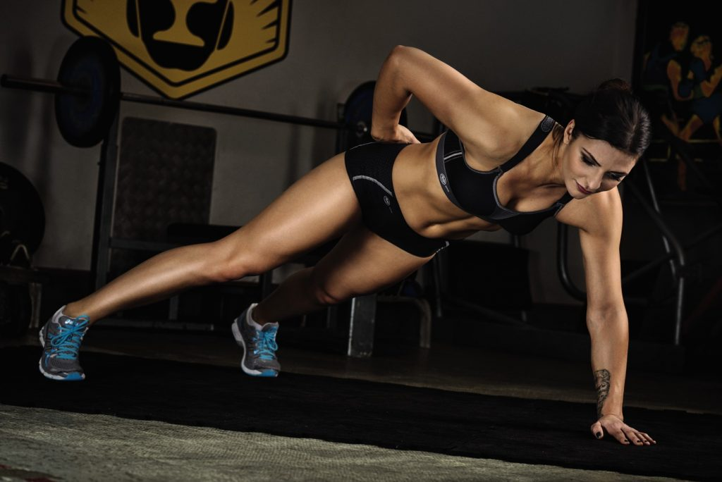 Christina Hammer preparing for summer with one handed push ups