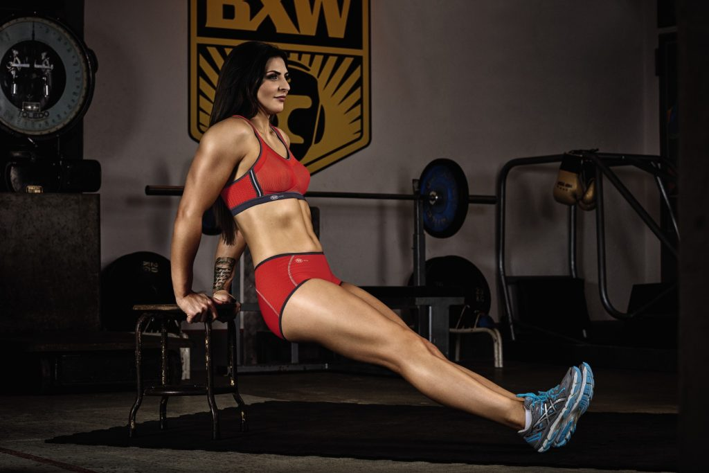 Boxing champion Christina hammer explains how to cerrectly execute tricep dips